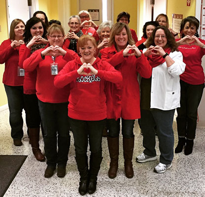 MCHD clinic staff show their support for Women's Heart Health on National Wear Red Day.